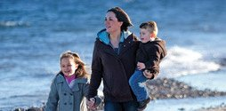 breast cancer survivor Rebecca Cross on the beach with her children