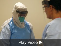 putting on and taking off Ebola PPE