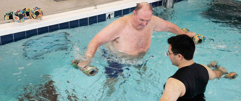 physicial therapy patient in rehab pool