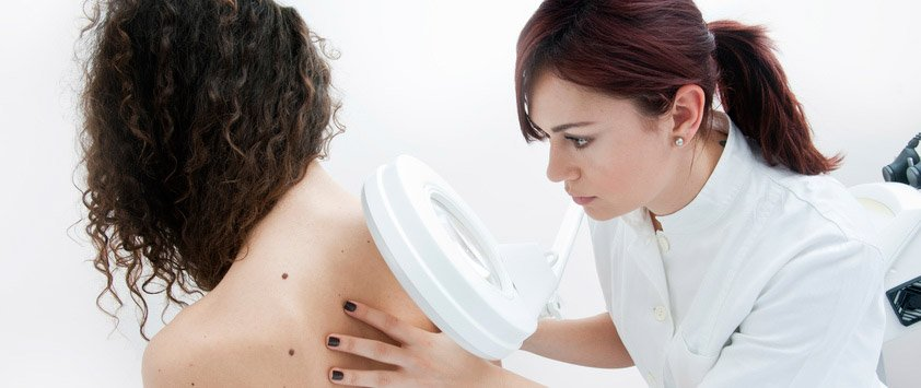 dermatologist examing patients skin